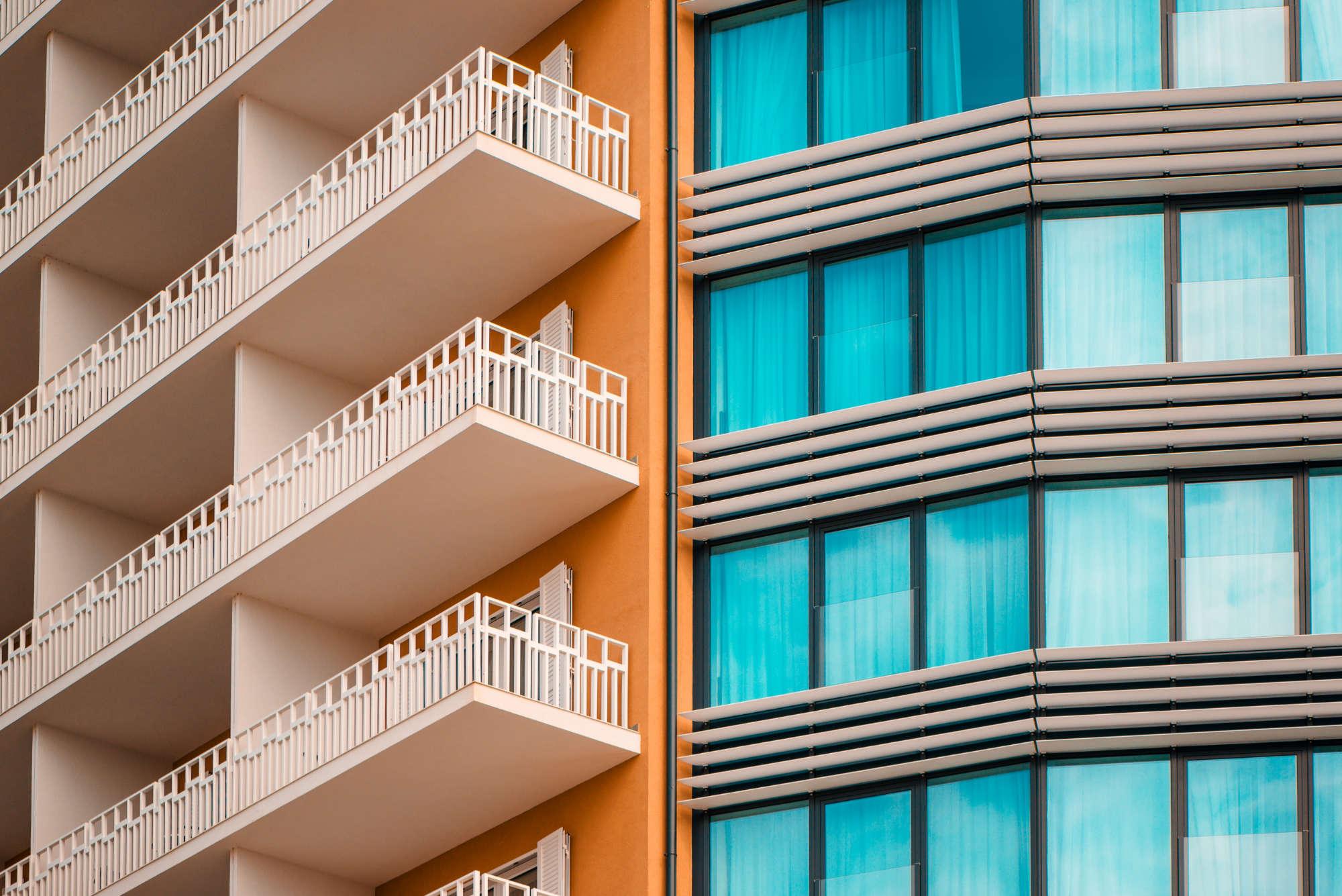 orange-and-teal-modern-building-facade-PH2QZAU.jpg